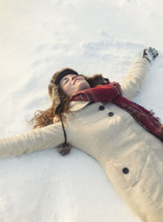 happy woman lying in snow